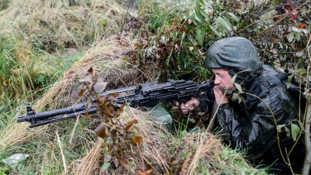 A handout photo from the Russian Defence Ministry shows a soldier aiming his weapon from a position, during the 2017 Zapad military exercises