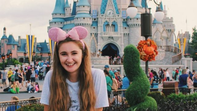 Emily at Disneyland in front af a castle
