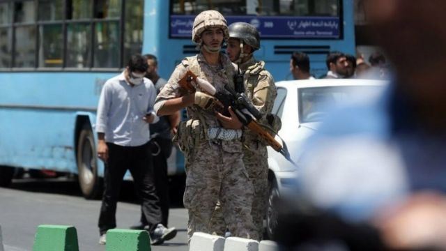 Iranian army soldiers stand near parliament building during an attack in Tehran, Iran, 07 June 2017