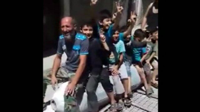 Children playing on a barrel bomb in Aleppo Syria