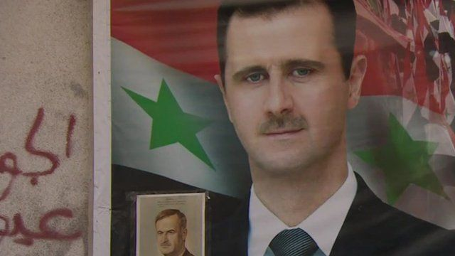 Poster on a wall in Syrian showing Bashar al-Assad