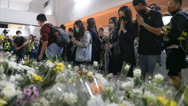 Crowds leave flowers in tribute to Mr Chow