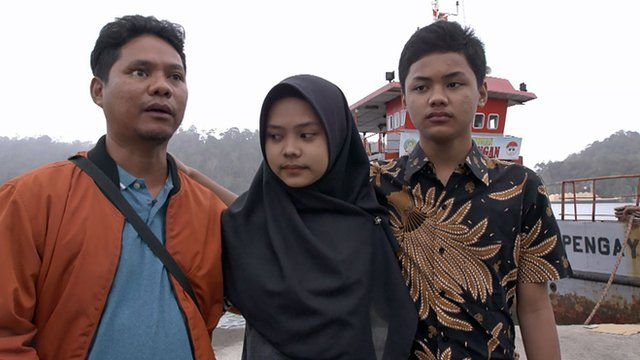 Iwan, Sarah and Rizqy at the port