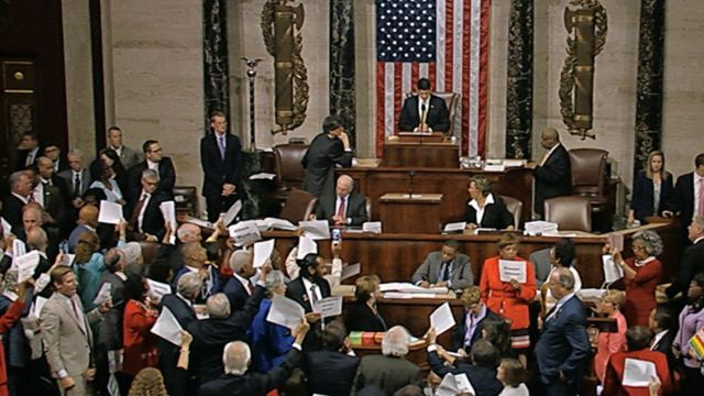 House Speaker Paul Ryan stands at the podium as he brings the House into session