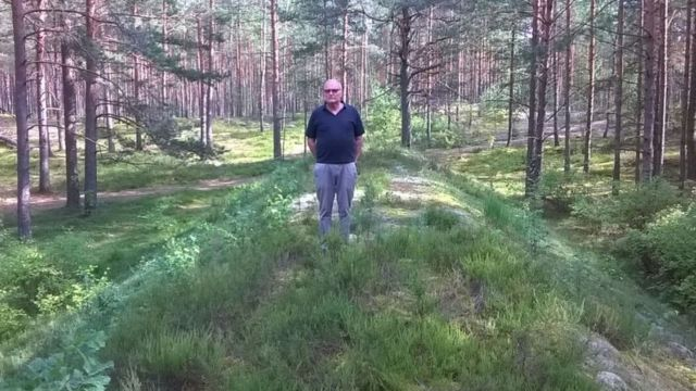 Dr Zuroff standing in front of a mass grave in Lithuania