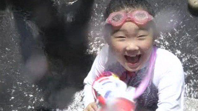 Girl at water gun festival