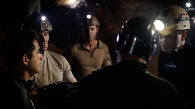Writer/director Tom Waller briefs his cast on the set of The Cave