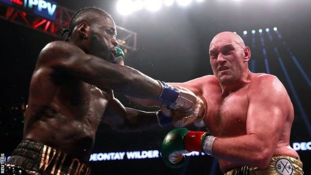 Deontay Wilder (l) and Tyson Fury