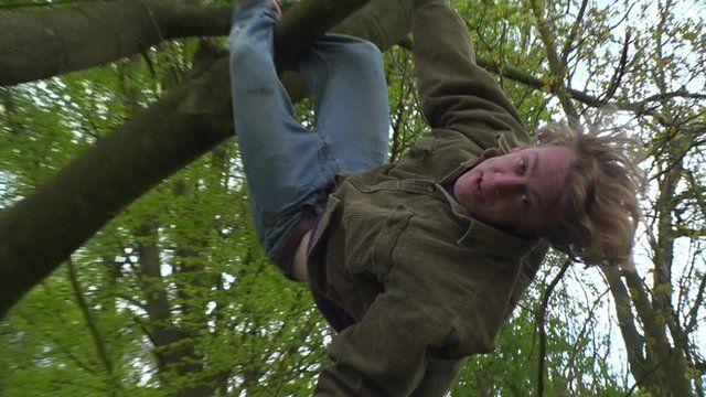Jack Cooke climbing a tree