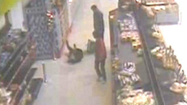 Louis Dempsey on the floor of the supermarket after pretending to fall