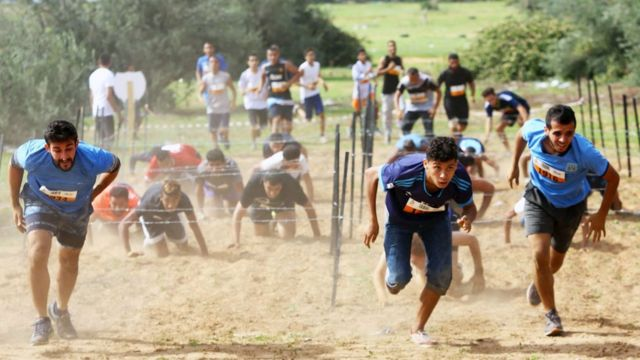 Libyan people wey dey race, from across Libya, for inside one 4km obstacle race, for di Tripoli wey be capital city on October 28, 2017