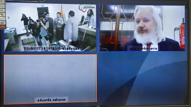 TOPSHOT - View of a screen showing WikiLeaks founder, Australian Julian Assange, in videoconference during a hearing at a provincial court in Quito on December 12, 2018. - Assange, 47, appealed a decision against Ecuador suspending a protocol -in force since October 12- which regulates his stay at the Ecuadorean Embassy in London.