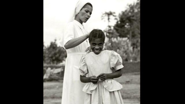 Nun and child at Catholic orphanage, Bailundo, Angola, 2008