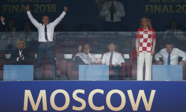 French President Emmanuel Macron celebrates France's win over Croatia in the 2018 World Cup final, 15 July 2018