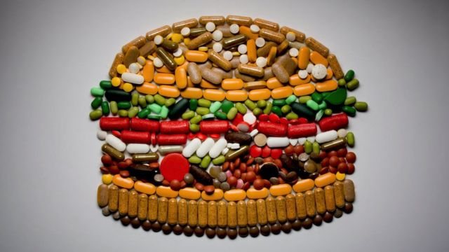 Concept image: a burger made up of pills and vitamins
