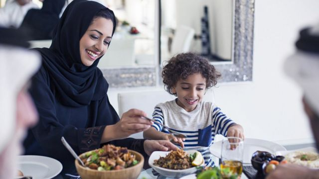 Muslim family at the dinner table