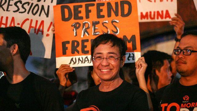 Participates calling for press freedom in Manila.