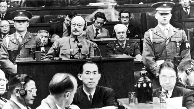 Former Japanese Prime Minister Hideki Tojo seen in a court surrounded by people