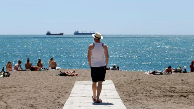Visitors enjoy the beaches in Malaga, Spain