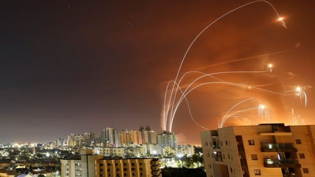Streaks of light are seen as Israel's Iron Dome anti-missile system intercepts rockets launched from the Gaza Strip towards Israel, as seen from Ashkelon, Israel (12 May 2021)