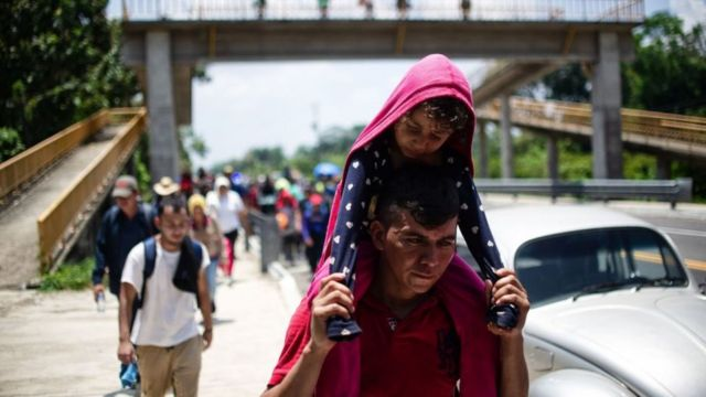 TOPSHOT - Central American migrants heading in caravan to the US rest beside the road between Metapa and Tapachula in Mexico on April 12, 2019