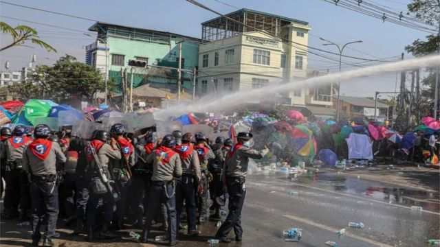 Police use a water cannon against demonstrators as they protest against the military coup and to demand the release of elected leader Aung San Suu Kyi, in Mandalay, Myanmar, February 9, 2021.