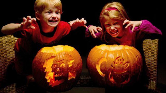 Children with pumpkins.