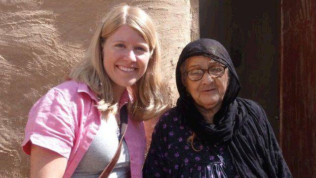 Dr Sarah Parcak and old woman