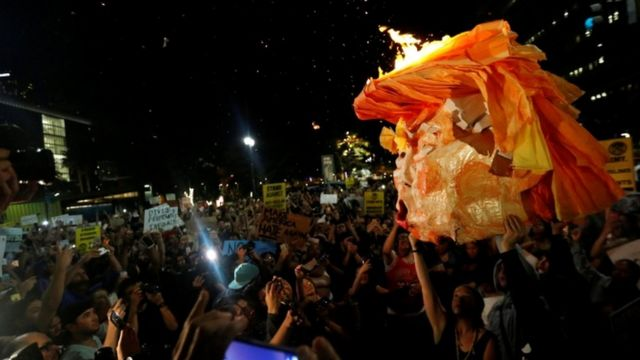 Protesters carry a Trump effigy in Los Angeles
