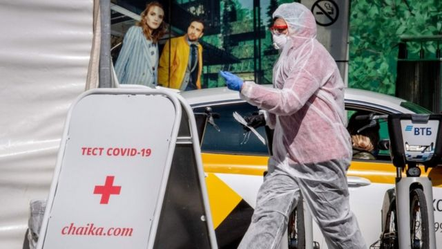 A medical staff walks near a testing point for Covid-19 in central Moscow
