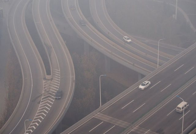Vehicles run in the heavy smog on 23 December 2015 in Shijiazhuang, Hebei Province of Chin