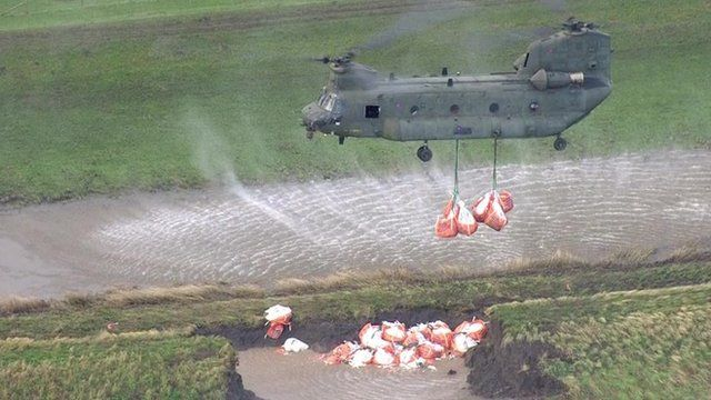 An RAF Chinook helicopter drops sandbags in Croston