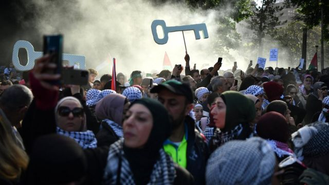 """Demonstrators take part in a """"Rally for Palestine"""" at Hyde Park, in Sydney, New South Wales, Australia, 22 May 2021. A ceasefire between Israel and the Palestinian militant group Hamas in the Gaza Strip was announced on 21 May, after 11 days of fighting in the Middle East."""
