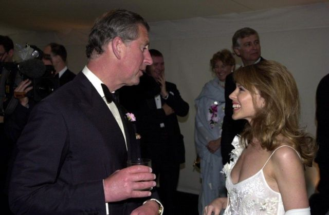 "The Prince of Wales and Kylie Minogue during the ""Its Fashion"" charity gala dinner at Waddesdon Manor, Buckinghamshire, on 11 June 2001"