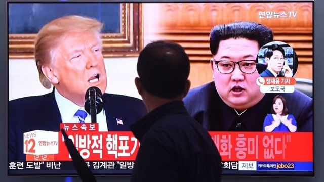 South Korean TV screen shows images of Donald Trump and Kim Jong-un side by side