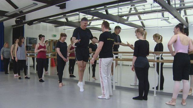 John Beattie at the barre