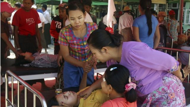 Women comfort a victim receiving treatment at temporary shelter outside the hospital after an earthquake in Taikkyi township northeast of Yangon, Myanmar, Tuesday, March 14, 2017. The U.S.