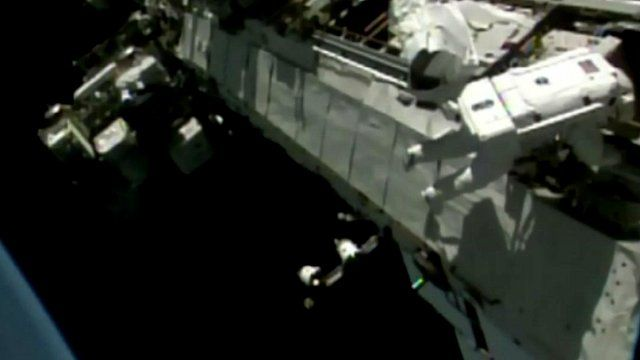 Tim Peake walks along the side of the International Space Station