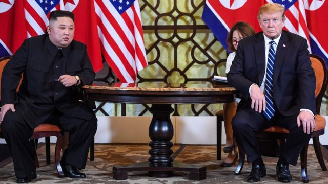 """US President Donald Trump (R) holds a meeting with North Korea""""s leader Kim Jong Un during the second US-North Korea summit at the Sofitel Legend Metropole hotel in Hanoi on February 28, 2019"""