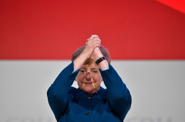 "German Chancellor and leader of the Christian Democratic Union (CDU) Angela Merkel acknowledges the applause after delivering her speech at a party congress of Germany""s conservative Christian Democratic Union (CDU) party on December 7, 2018 at a fair hall in Hamburg, northern Germany. - German Chancellor Angela Merkel will hand off leadership of her party after nearly two decades at the helm, with the race wide open between a loyal deputy and a longtime rival. (Photo by John MACDOUGALL / AFP)JOHN MACDOUGALL/AFP/Getty Images"