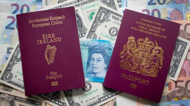 Irish and British passports on top of mixed currency