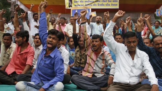 "Members of India""s low-caste Dalit community shouts slogans during a sit in protest against the alleged attack on their community members for skinning a dead cow in Una, in Ahmadabad, India, Friday, July 22, 2016."