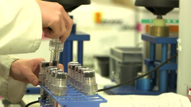 Scientist handling test tubes