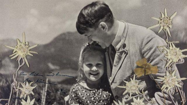 Adolf Hitler hugs Rosa Bernile Nienau in a signed picture