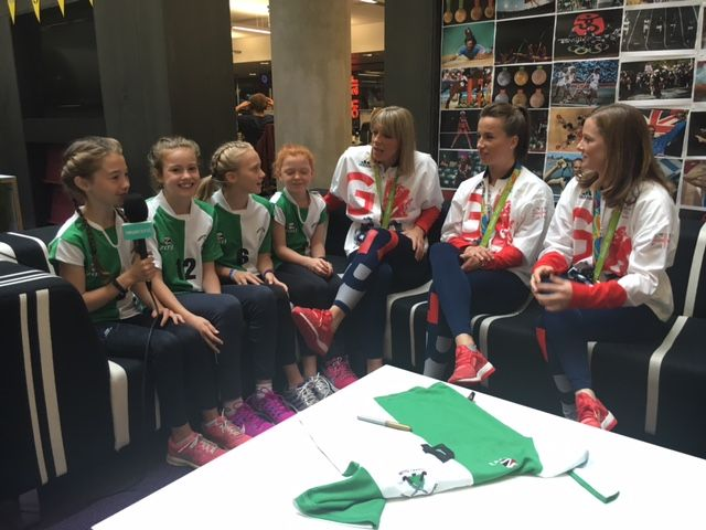 Three Team GB hockey players answer questions from some young players