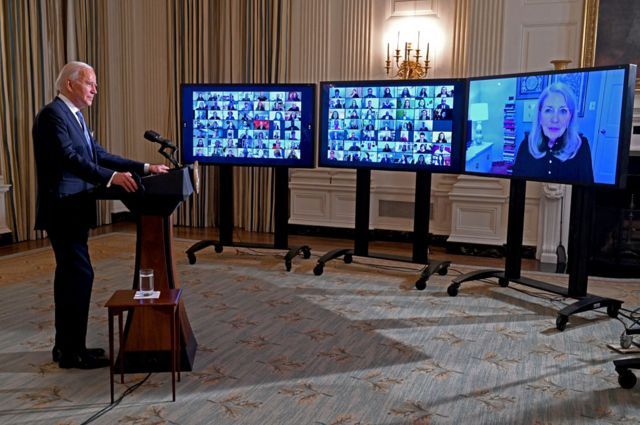 President Biden speaks to dozens of people in a video conference
