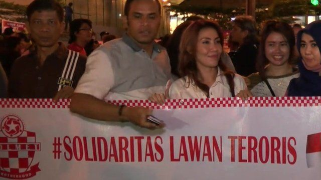 Protesters in Jakarta hold banner