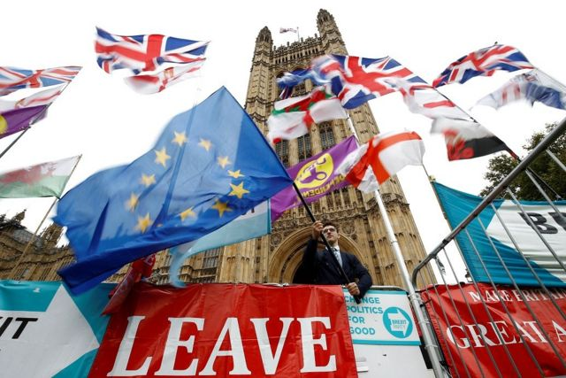 An anti-Brexit protester waves an EU flag outside the Houses ofParliamentin London, Britain, October 25, 2019