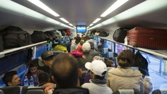 Migrants pack a train leaving Vienna, in Austria