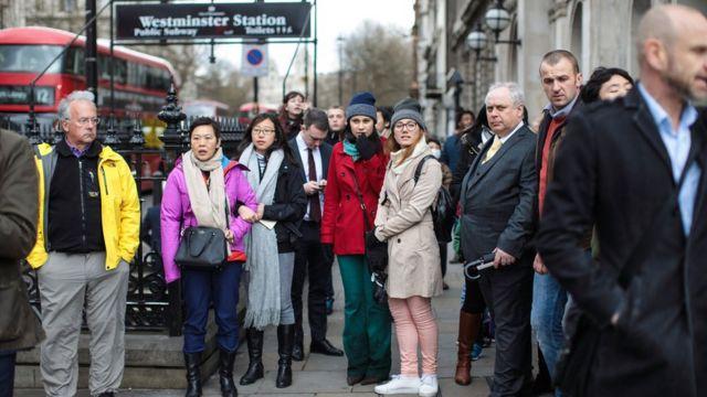 Crowd held back outside Westminster Tube Station.